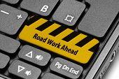 Road Work Ahead. Yellow Warning Key On Computer Keyboard