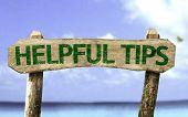 picture of hippy  - Helpful Tips sign with a beach on background - JPG