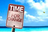 Time For Change sign with a beach on background