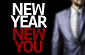 Business man with the text Great Ideas New Year New You in a concept image