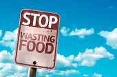 Stop Wasting Food sign with sky background