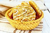 Cookies with sesame and sunflower in wicker bowl