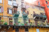 Picturesque House On The Square Piazza Delle Erbe On A Sunny Day. Verona, Italy