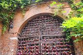 Many Love Locks On The Gate Of The Juliet House In Verona, Italy