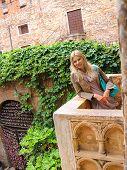 picture of juliet  - Attractive girl is standing on the balcony of Juliet in Verona Italy - JPG