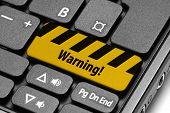 Warning!. Yellow Warning Key On Computer Keyboard