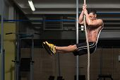 stock photo of lifting weight  - Fitness Rope Climb Exercise In Fitness Gym Workout - JPG