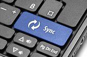 Synchronization. Blue Hot Key On Computer Keyboard.