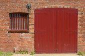 Red Door And Window In Brick Wall