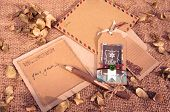 stock photo of sad christmas  - Christmas card from ancient material with vintage style wooden pen - JPG