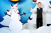 image of boys night out  - Cheerful boy in a cartoon fairy snowy forest - JPG