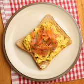 Scrambled eggs with smoked salmon on toast.