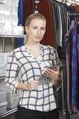 Businesswoman Running On Line Fashion Business With Digital Tabl