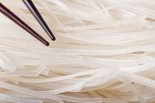 Dry Rice Noodles With Chopsticks Macro.