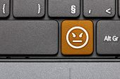 Anger. Orange Hot Key Emoticon On Computer Keyboard.