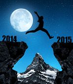 Girl jumps to the New Year 2015 in the background mount Matterhorn.