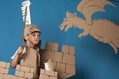 pic of berserk  - photo of the boy in medieval knight costume made of cardboards - JPG