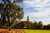 stock photo of stratus  - polish village with the church - JPG