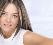 pic of nose piercing  - Young, nice woman with freckled skin and piercing in nose - JPG