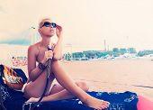 pic of hookah  - Woman with hookah on the beach in bikini - JPG