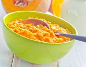 foto of porridge  - pumpkin porridge in bowl and on a table - JPG