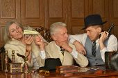 stock photo of gangster  - Gangsters companions on the table in retro style - JPG