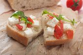 picture of tomato sandwich  - Close up of a healthy sandwich with cheese tomato aolive oil and rocket seasoned with black pepper - JPG