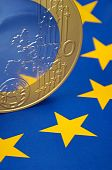 Euro coin on a european flag