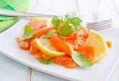 image of redfish  - fresh salmon with lemon on the white plate - JPG