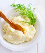 stock photo of mashed potatoes  - mashed potato in bowl and on a table - JPG