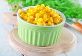 stock photo of sweet-corn  - sweet corn in bowl and on a table - JPG