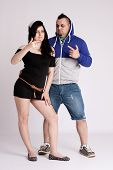 picture of rapper  - Young couple in rapper clothes posing in the studio - JPG