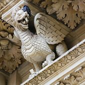 foto of church  - Dragon statue at the Basilica of Santa Croce or Church of the Holy Cross a famous baroque church in Lecce historic city in Apulia Southern Italy - JPG