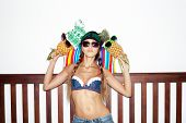 foto of crazy hat  - Young funny fashion crazy blonde girl posing in summer style outfit with pineapples - JPG