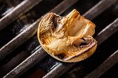 pic of champignons  - Champignon white mushroom grilled on grill or BBQ with seasoning - JPG