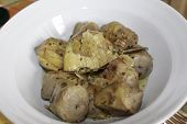 picture of artichoke hearts  - Artichoke hearts covered in herbs served as an appetizer - JPG