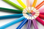 stock photo of color wheel  - Color pencils arranged in a color wheel on a white background - JPG