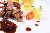 stock photo of veal  - Tenderloin of veal with sauce of figs - JPG