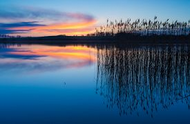 stock photo of morning sunrise  - Beautiful sunset over calm lake - JPG
