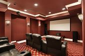 pic of home theater  - Theater room in luxury home with stadium seating - JPG