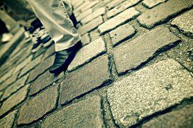 pic of street-walker  - Stone floor background in Paris - JPG
