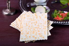 image of seder  - Matzo for Passover with Seder meal on plate on table close up - JPG