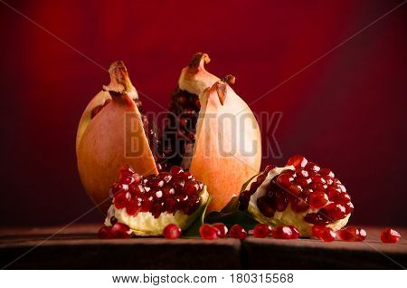 poster of The Pomegranate Is Ripe. Cut Into Pieces Of Ripe Pomegranate. On Wooden Boards.