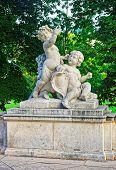 Angel Putti Statue In Burggarten Park In Vienna poster