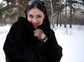 stock photo of polly  - The girl in a fur coar smiling girl - JPG