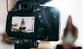 Young Female Vlogger On Camera Screen. poster