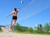 Playing Beach Volleyball - Teen Jumps High After Ball