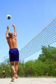 People Playing Beach Volleyball - Balding Man