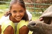 School girl with giant tortoise