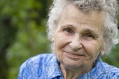 stock photo of elderly woman  - portrait of the elderly woman in the park - JPG